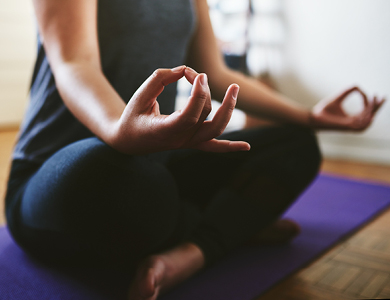 a person sitting in a yoga pose