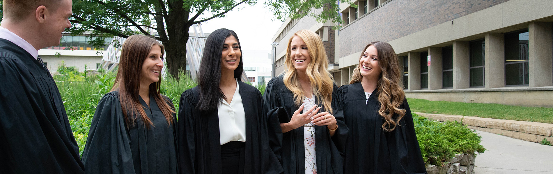 5 Mohawk students after convocation in grad robes.jpg
