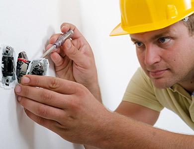 electrician installing a plug