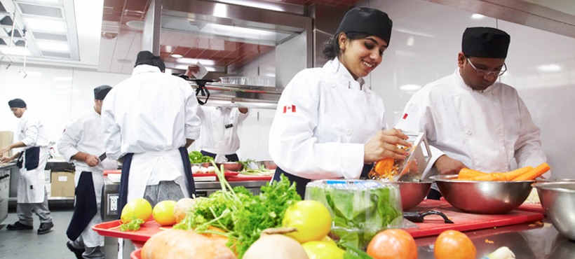 Chefs working with local food in a kitchen