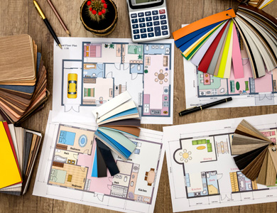 room plans and colour swatches on a desk