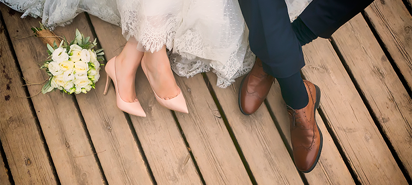 Bride and Groom's feet sitting down
