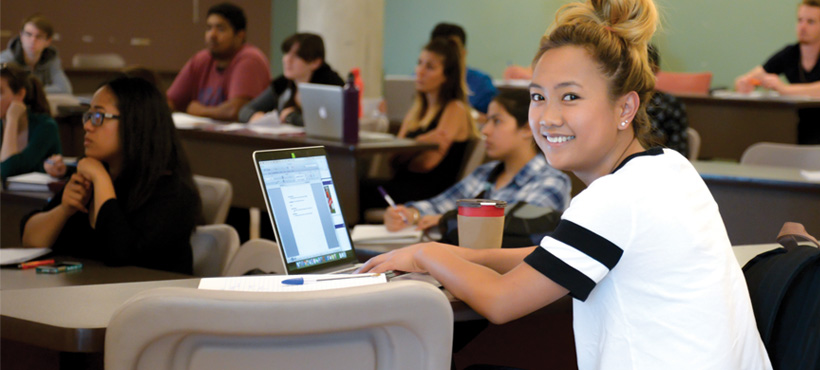 a student using her laptop