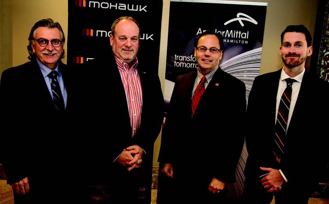 Tony Valeri, Sean Donnelly, Ron McKerlie and Kyle Datzkiw standing for a photo