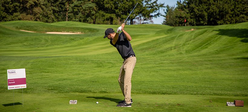 golfer taking a swing at the President's Golf Classic