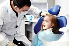dentist with child