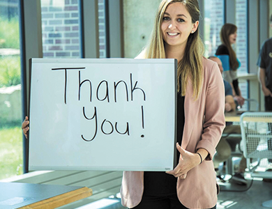 Student Holding a Thank You Sign