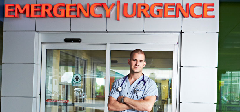 a nurse in front of the emergency room