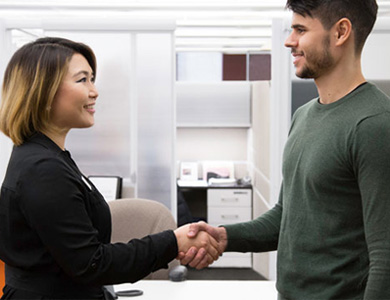 international recruiter shaking hands with student
