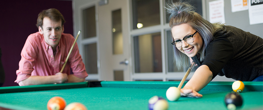 Two Mohawk students playing pool in the Mohawk Residence