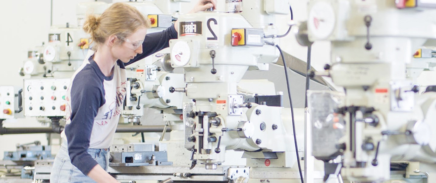 Student working in a machine shop