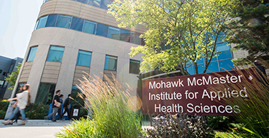Students walking near the entrance to the Mohawk McMaster Institute for Applied Health Sciences
