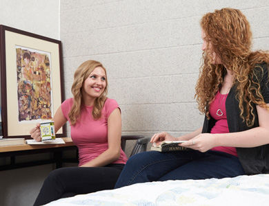 students conversing in mohawk residence