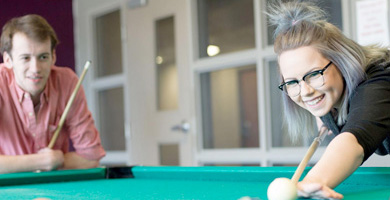 students in mohawk residence playing pool