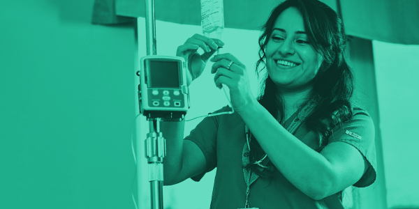 Nurse smiling and working with equipment