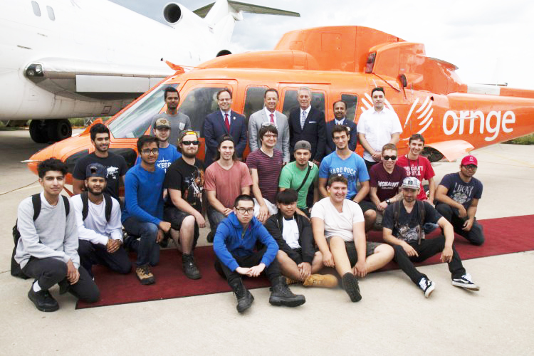 mohawk students in front of donated ornge helicopter
