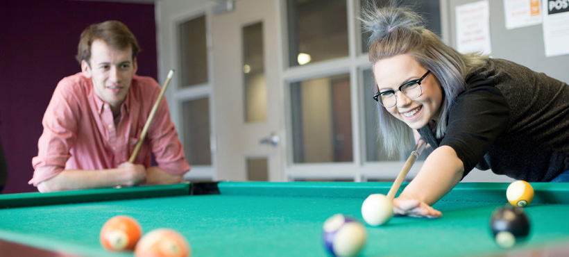 mohawk student's playing pool in residence