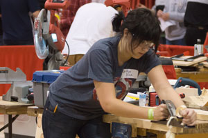 student working on carpentry