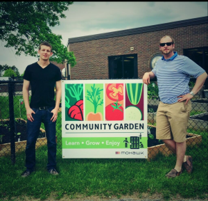 Mohawk College Sustainability Team Standing by the Community Garden Sign