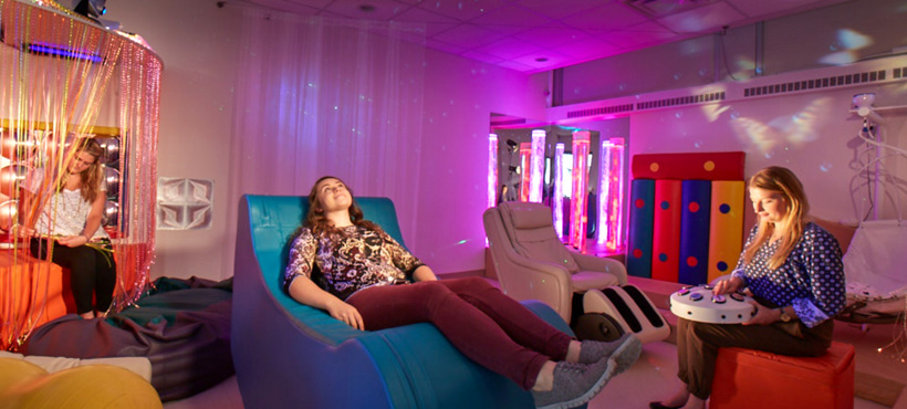 Student sitting in the multi-sensory lab.