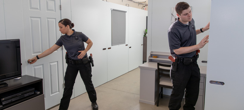 Students using the Mohawk College Police Tactical House