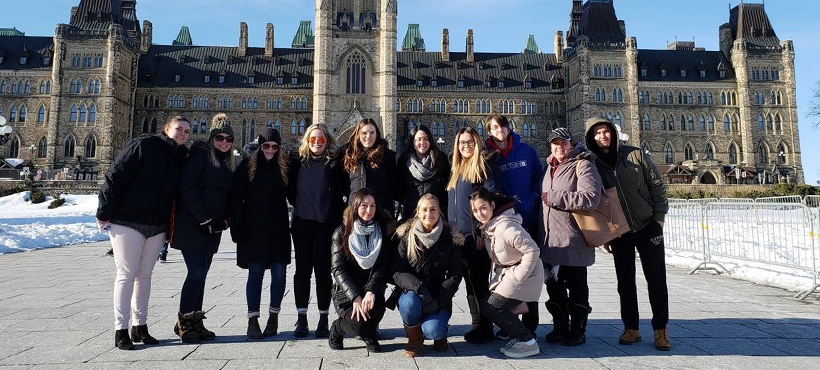 mohawk students on a field trip to ottawa, posing outside the parliament building