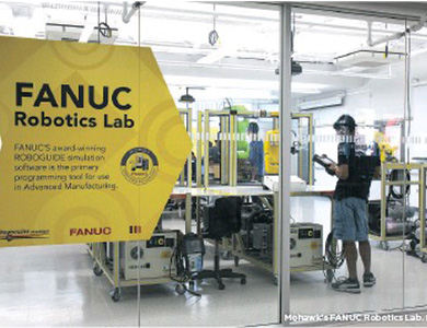 student at fanuc lab
