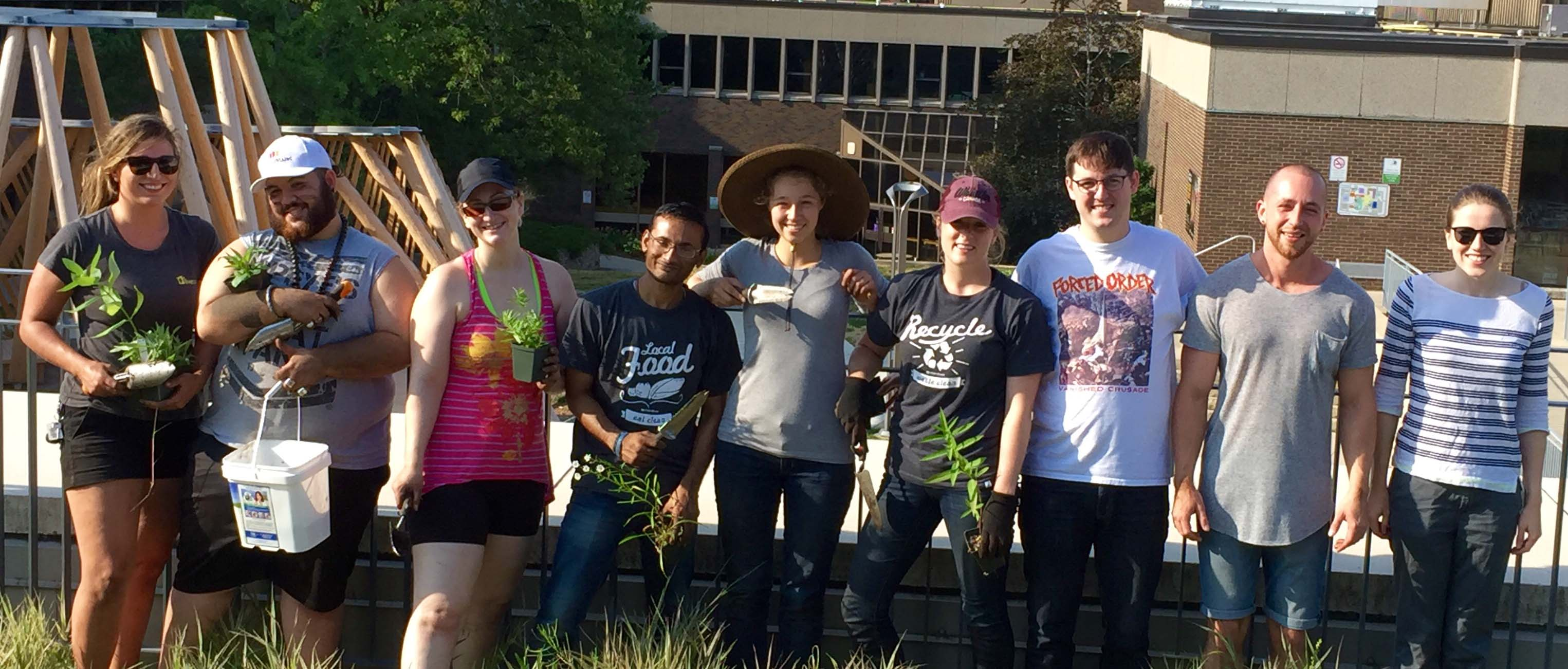 sustainability volunteers at the pollinator garden planting