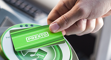 hand holding presto card.png