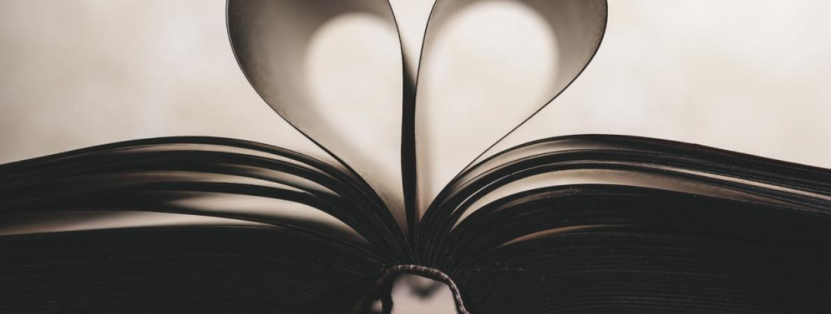 book open with middle pages in the shape of heart