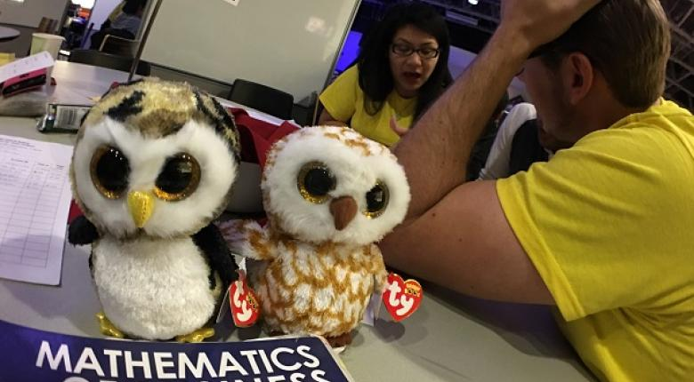 Stuffed owls with two tutors at the Business Math table