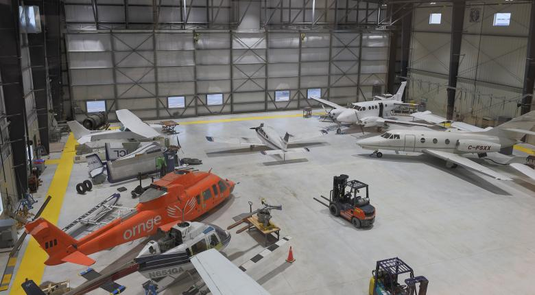 Aircrafts and helicopters in the Centre for Aviation Technology at Hamilton International Airport (YHM) building