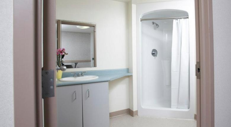 washroom photo showing sink and shower