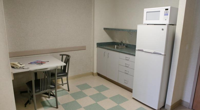 Kitchenette with microwave, full sized fridge and sitting area