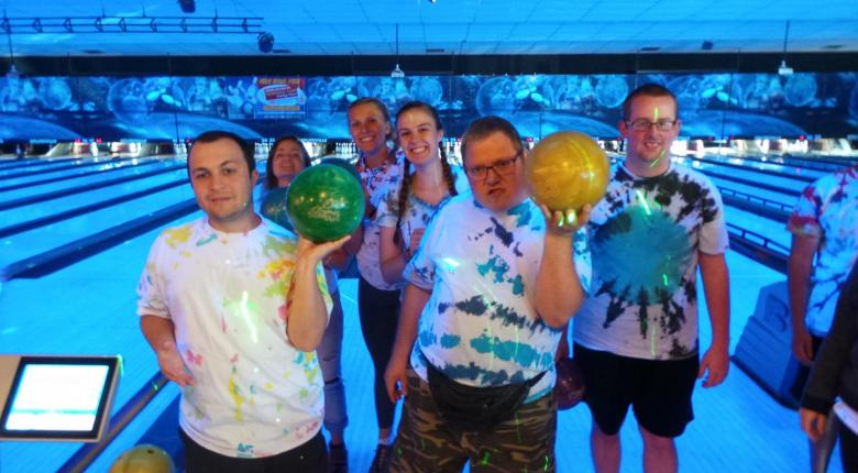 Participants posing at a bowling alley