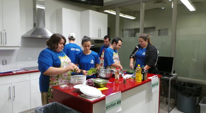 Camp participants making salad