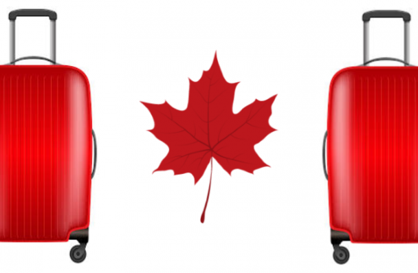 Two red suitcases and a maple leaf arranged like a Canada Flag