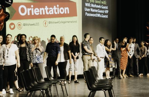 Mohawk staff on stage on International Student Orientation event