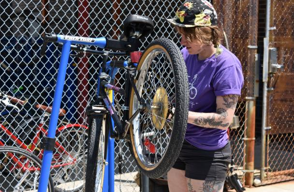 person from New Hope Bikes performing a bike tune up