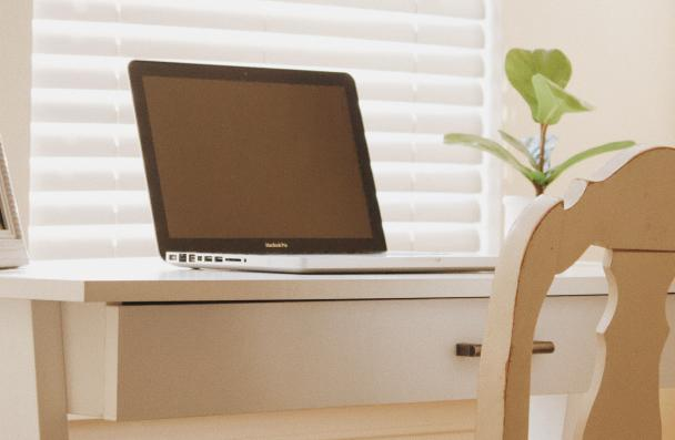 laptop on clean white desk