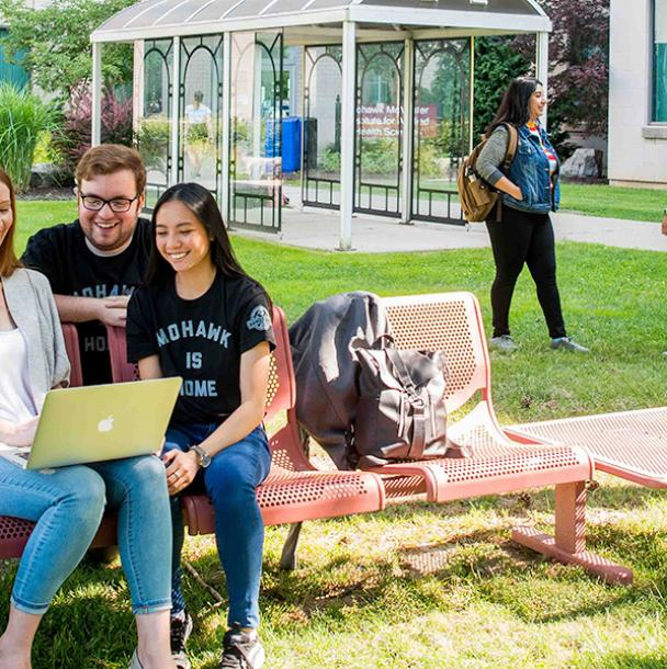 group of students studying outside of IAHS