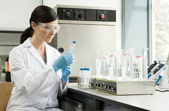 Student in a clinical lab testing.