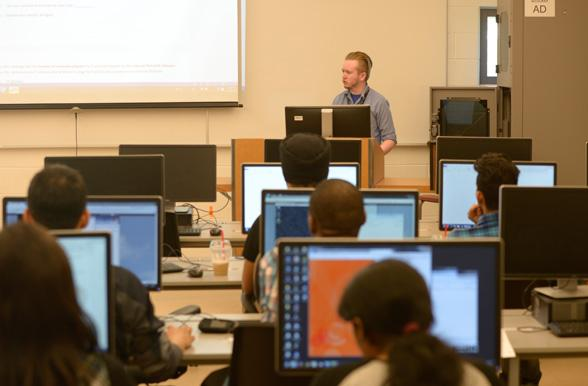 Instructor teaching students in computer lab at Mohawk College