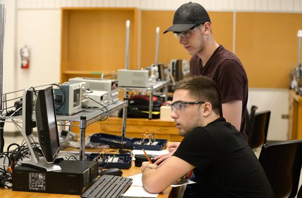 Electrical Engineering students writing notes at Mohawk College