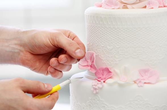 student decorating a cake - Cake Decorator