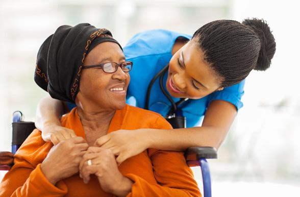 african senior patient with female nurse