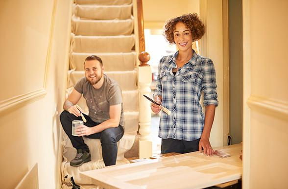 Two people doing home renovation