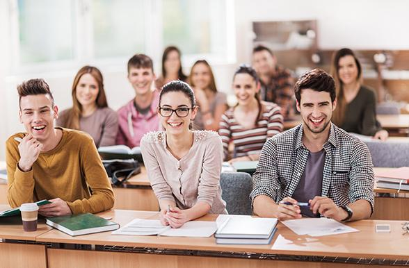 Students smiling in a classroom