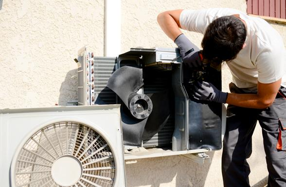 Mechanic working on a residential air conditioning unit