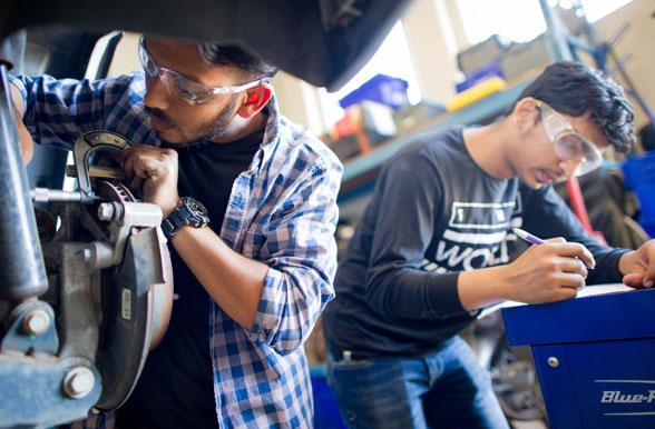 Students working on a car brake